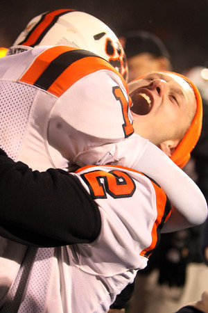 Beverly junior Nick Manthorne, right, picks up senior quarterback Dave Rollins, left, in a bear hug following the Panthers 34-21 victory over the Red Devils to advance to the Eastern Mass D2A Final. David Le/Staff Photo