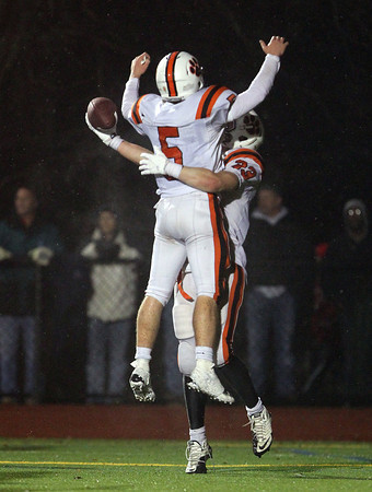Beverly senior captain Dom Abate celebrates another Panther touchdown with senior captain Brendan Flaherty on Tuesday evening.David Le/Staff Photo