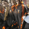 From left, Beverly High School cheerleaders junior Tatum Geary and sophomores Kelly Pierce and Kendel Davey, pose for a photo during the Panthers' Eastern Mass D2A semi-final game against Burlington on Tuesday night. David Le/Staff Photo