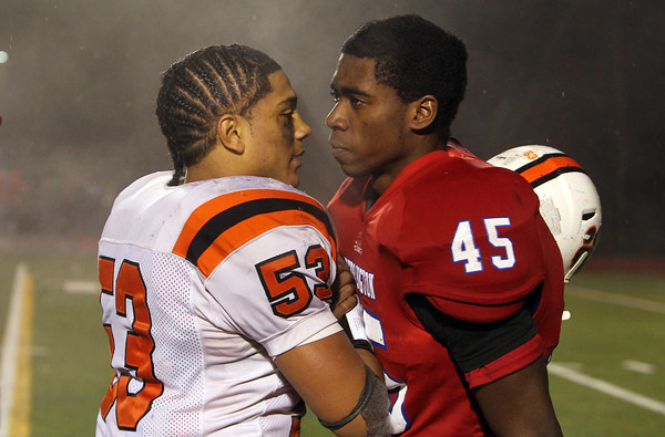 Beverly junior Sean Winston, left, shakes hands with Burlington senior Marcus Aaron Odiah, right, after the Panthers defeated the Red Devils 34-21 in the Eastern Mass D2A semi-final on Tuesday evening. David Le/Staff Photo