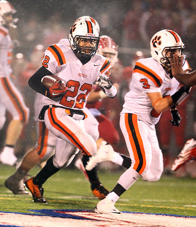 Beverly junior running back Isiah White uses a block from senior Ryan Shipp, right, and sprints forward for a huge gain against Burlington on Tuesday evening. David Le/Staff Photo
