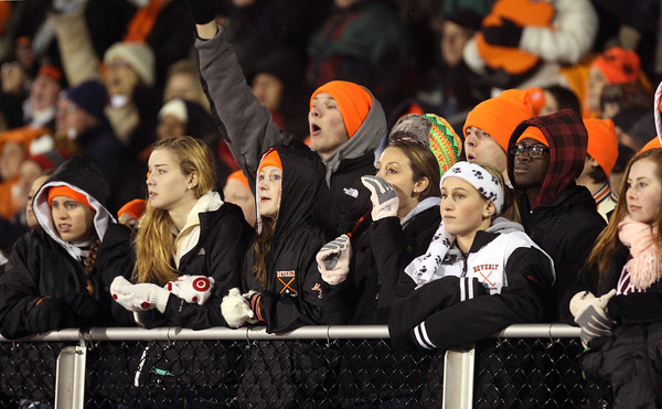Some Beverly High School fans lining the railing of the bleachers cheer on the Panthers as they taken on Burlington in the Eastern Mass D2A semi-final on Tuesday evening at Varsity Field in Burlington. David Le/Staff Photo