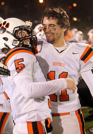Beverly junior Jack Morency, right, celebrates the Panthers 34-21 victory over Burlington with senior captain Dom Abate, following the Eastern Mass D2A semi-final. David Le/Staff Photo