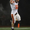 Beverly High School senior Brian Perry leaps up in the air in celebration after the Panthers stopped Burlington on a 4th down play to seal the game for the Panthers. Beverly advances to the Eastern Mass D2A Final with a 34-21 victory on Tuesday evening. David Le/Staff Photo