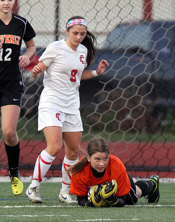 Beverly junior goalkeeper Casey Cook dives on top of a loose ball while shielding Central Catholic junior Megan Rauseo, left, on Sunday afternoon in the D1 North Final match at Manning Field in Lynn. Cook made 19 saves to lead the Panthers to a 4-1 PK victory over the Raiders to advance to the E-Mass Title game. David Le/Staff Photo