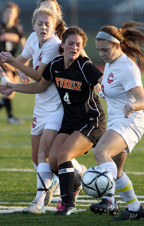 Beverly senior captain Becca Kemmer, center, fights through Central Catholic's Brenna Lonneman, left, and Alex Nagri, right, and tries to win possession of the ball. Beverly defeated Central Catholic 4-1 on PK's to capture the D1 North Title. David Le/Staff Photo