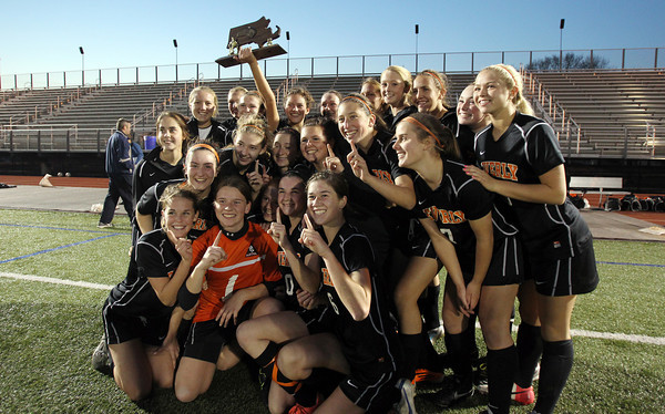 The 2012 D1 North Girls Soccer Champion Beverly Panthers hold up the trophy following an emotional PK victory over Central Catholic on Sunday afternoon. David Le/Staff Photo