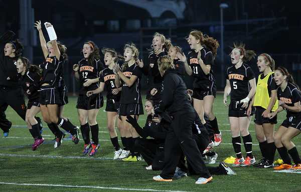 Members of the Beverly girls soccer team react after junior Caitlin Harty buried the team's 1st PK against Central Catholic on Sunday afternoon. The Panthers and Raiders battled to a 1-1 tie through regulation and 2OT periods, then Beverly netted four of their first four penalty kicks to send them to a 4-1 victory and their first D1 North Title in school history. David Le/Staff Photo