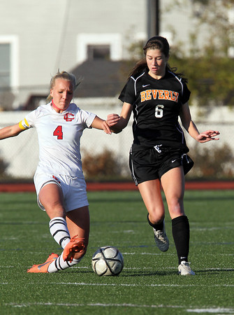 Beverly junior striker Caitlin Harty races upfield while being contested by sliding Central Catholic defender Maggie Carey, left, on Sunday afternoon in the D1 North Final at Manning Field in Lynn. Harty scored the Panthers only goal in regulation to tie the game at 1-1. The Panthers and Raiders battled to a 1-1 tie after regulation and two overtime periods, then the Panthers converted their first 4 penalty kicks and downed CC 4-1 to capture their first ever D1 North Title. David Le/Staff Photo