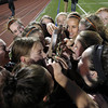 The Beverly High School girls soccer team kiss the MIAA D1 North Soccer trophy after they downed Central Catholic on PK's 4-1 to capture their first ever North Title on Sunday afternoon at Manning Field in Lynn. David Le/Staff Photo