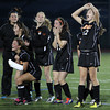 Members of the Beverly girls soccer team react after sophomore Eva Gourdeau buried the team's 2nd PK against Central Catholic on Sunday afternoon. The Panthers and Raiders battled to a 1-1 tie through regulation and 2OT periods, then Beverly netted four of their first four penalty kicks to send them to a 4-1 victory and their first D1 North Title in school history. David Le/Staff Photo