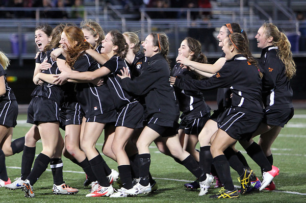 The Beverly High School girls soccer team mob junior captain Diandra Crowley, left, after she hit the game-winning penalty kick against Central Catholic, giving the Panthers their first D1 North Girls Soccer Title in school history. The Panthers and Raiders were deadlocked at 1-1 through regulation and 2OT periods and the game was decided on PK's. David Le/Staff Photo