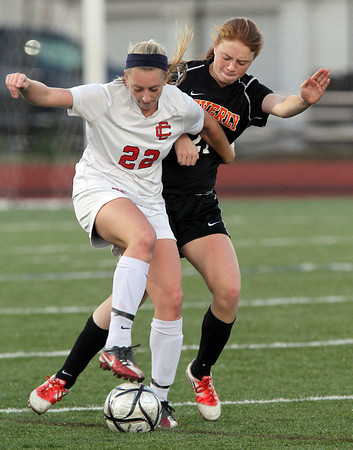 Beverly sophomore back Rose Terner, right, tightly defends Central Catholic forward Courtney Walsh, left, on Sunday afternoon in the D1 North Final at Manning Field in Lynn. The Panthers defeated the Raiders 4-1 on PK's to capture their first ever Girls Soccer D1 North Title. David Le/Staff Photo