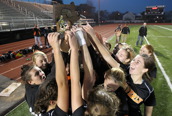 The Beverly High School girls soccer team hold up the MIAA D1 North Soccer trophy after they downed Central Catholic on PK's 4-1. David Le/Staff Photo