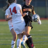 Beverly senior captain Becca Kemmer, right, collides with Central Catholic junior Brenna Lonneman, left, as they battle for possession of a loose ball on Sunday afternoon in the D1 North Final at Manning Field in Lynn. The Panthers won their first Girls Soccer D1 North Championship and advance to Eastern Mass Final. David Le/Staff Photo
