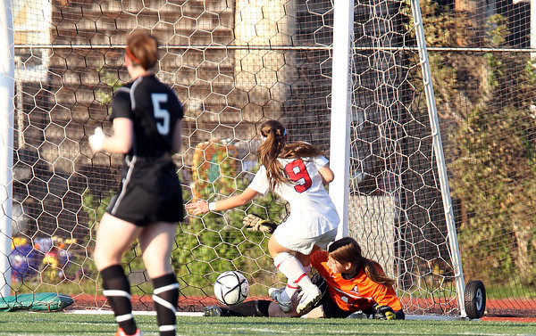 Beverly junior goalkeeper Casey Cook makes a lunging save on Central Catholic junior Megan Rauseo, left, on Sunday afternoon. Cook made 19 saves for the Panthers as they captured their first ever Girls Soccer North Title. David Le/Staff Photo