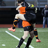 Beverly senior Kristen O'Connor jumps into the waiting arms of junior goalkeeper Casey Cook after the Panthers defeated Central Catholic 4-1 on PK's to capture the D1 North Girls Soccer Title on Sunday afternoon. David Le/Staff Photo