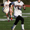 Beverly junior striker Caitlin Harty chases down a loose ball against Concord-Carlisle on Tuesday afternoon. Harty scored a goal in each half and propelled the Panthers to a 2-0 victory over CC in the D1 North Quarterfinal. David Le/Staff Photo