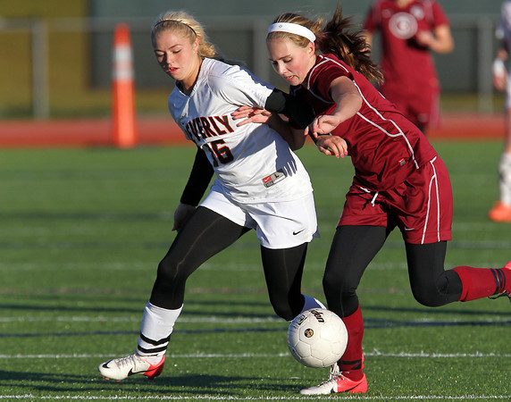 Beverly sophomore midfielder Eva Gourdeau, left, and Concord-Carlisle freshman Maeve Rabbitt, right, battle for possession of the ball during the second half of play. Beverly defeated CC 2-0 to advance to the D1 North Semi-Final game. David Le/Staff Photo