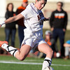 Beverly senior defense Kristen O'Connor drives a free kick on net against Concord-Carlisle during D1 North Quarterfinal action on Tuesday afternoon. A late game free kick by O'Connor set up junior teammate Caitlin Harty for the Panthers' second goal of the game, sending Beverly to the D1 North Semi-Finals. David Le/Staff Photo