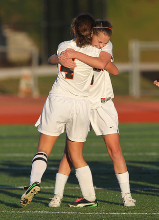 Beverly seniors captain Becca Kemmer, left, and Allison Collins, right, hug after defeating Concord-Carlisle in the D1 North Quarterfinals on Tuesday afternoon in Beverly. David Le/Staff Photo