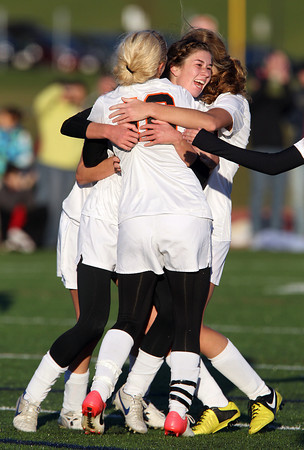 Beverly junior striker Caitlin Harty, center, gets mobbed by her teammates after she scored her second goal of the game, sealing a 2-0 victory for the Panthers over Concord-Carlisle and advancing Beverly to the D1 North Semi-Final. David Le/Staff Photo