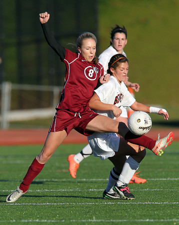 Beverly senior captain Becca Kemmer, right, steps in to break up a pass intended for Concord-Carlisle's Emma Brandhorst, left, on Tuesday afternoon. The Panthers shut out CC 2-0 and advanced to the D1 North Semi-Final. David Le/Staff Photo