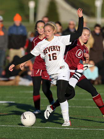 Beverly Sophomore midfielder Eva Gourdeau, left, keeps possession of the ball after being tripped up by Concord-Carlisle senior back Michaela Haller, right. Gourdeau and the Panthers advanced to the D1 North Semi-Finals with a 2-0 victory over CC on Tuesday afternoon. David Le/Staff Photo