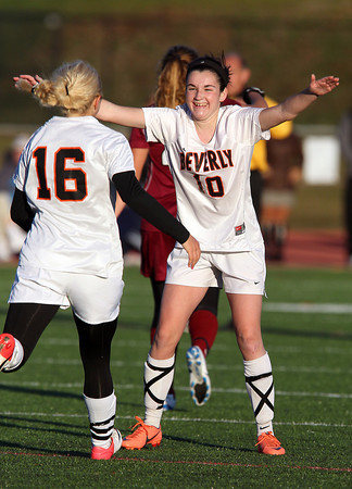 Beverly senior defender Kristen O'Connor, right, waits with open arms as teammate sophomore Eva Gourdeau, left, runs over to celebrate. O'Connor lofted a free kick into the box that junior striker Caitlin Harty put away for her second goal of the game, and solidified a 2-0 victory for the Panthers over Concord-Carlisle on Tuesday afternoon. David Le/Staff Photo