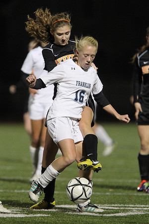 Beverly senior Meggie Manzo, left, reaches in with her left foot to challenge Franklin freshman Victoria stowell, right, on Wednesday evening. The Panthers fell 2-0 to Franklin in the D1 State Semi-Final at Manning Field in Lynn. David Le/Staff Photo