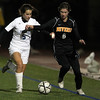 Beverly junior striker Caitlin Harty, right, battles with Franklin sophomore Erin Conley, left, for a 50/50 ball on Wednesday evening in the D1 State Semi-Final match at Manning Field in Lynn. David Le/Staff Photo