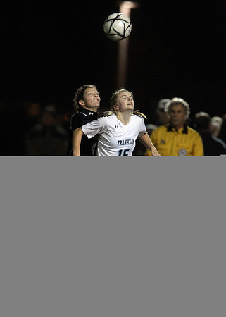 Beverly senior captain Becca Kemmer, left, contests a head ball against Franklin freshman Bailey Knous, right, on Wednesday evening in the D1 State Semi-Final. David Le/Staff Photo