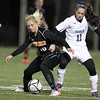 Beverly sophomore Eva Goudreau, left, uses her body to shield Franklin sophomore Nicole Ellin, right, on Wednesday evening in the D1 State Semi-Final match at Manning Field in Lynn. David Le/Staff Photo