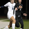 Beverly junior Caitlin Harty, right, gets mixed up with Franklin senior Grace Conley, left, as they battle for possession of the ball on Wednesday evening in the D1 State Semi-Final match. David Le/Staff Photo