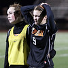 Beverly freshman Sarah Visnick, left, puts a comforting arm around junior captain Diandra Crowley, after the Panthers fell 2-0 to Franklin in the D1 State Semi-Finals on Wednesday evening at Manning Field in Lynn. David Le/Staff Photo