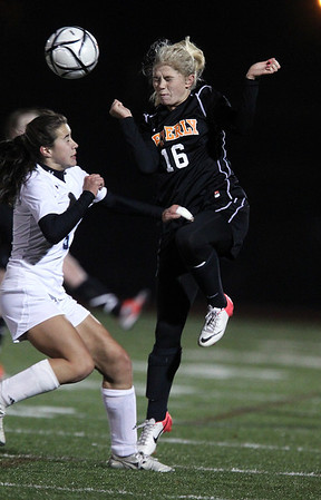 Beverly sophomore Eva Goudreau, right, wins a leaping headball against Franklin sophomore Erin Conley, left, on Wednesday evening. David Le/Staff Photo