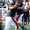 Beverly senior captain Marc Babcock, left, lifts up teammate junior Sean Winston, right, as they begin to celebrate the Panthers 35-14 victory over Marblehead on Saturday afternoon at Hurd Stadium after they clinched the NEC/CAL Tier 2 Championship. David Le/Staff Photo