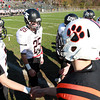 Marblehead senior captain and quarterback Ian Maag, left, and Beverly senior captain and quarterback Dave Rollins shake hands at midfield prior to the start of the Magicians and Panthers NEC/CAL Tier 2 Championship game on Saturday afternoon. David Le/Staff Photo