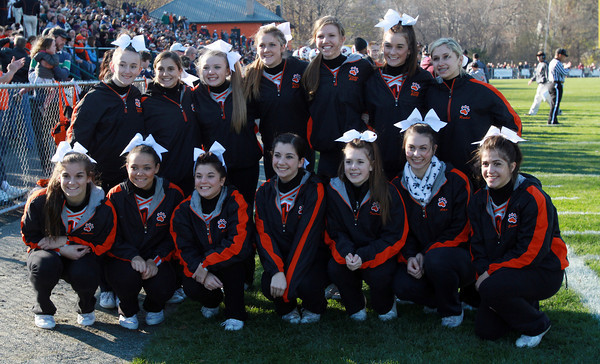 The Beverly High School cheerleaders pose for a team photo on Saturday afternoon during the Beverly-Marblehead football game. David Le/Staff Photo