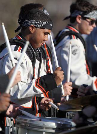 Beverly High School senior drummer Nelson Allen plays the drums during the Beverly HS Band pregame show on Saturday afternoon. David Le/Staff Photo