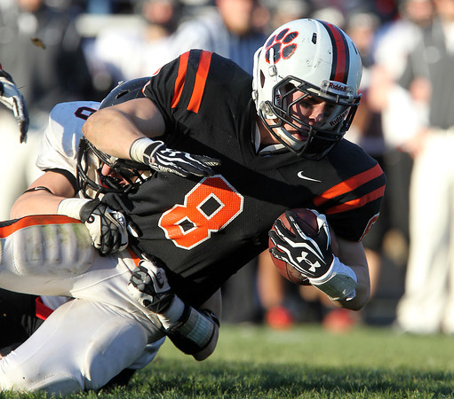 Beverly senior running back Luke McDonald dives forward for a few extra yards while being brought down by a Marblehead defender on Saturday afternoon. Beverly defeated Marblehead 35-14 in the NEC/CAL Tier 2 Championship. David Le/Staff Photo