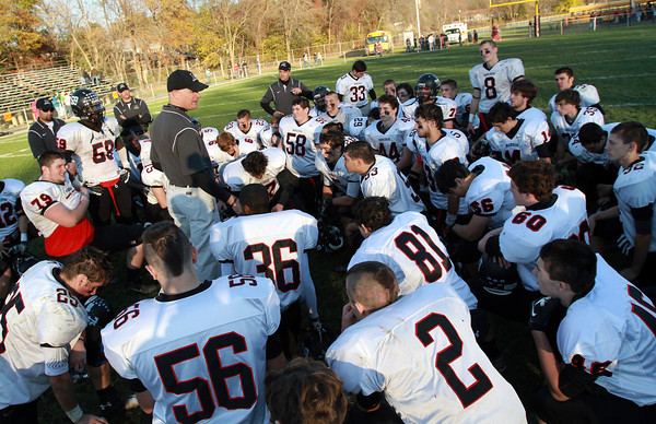 Marblehead Head Coach Jim Rudloff speaks to his team following a 35-14 loss to Beverly on Saturday afternoon. David Le/Staff Photo
