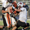 Beverly senior running back Luke McDonald, center, gets dragged down after a big gain by Marblehead's Ian Maag, left, and Sam Stern, right, on Saturday afternoon. David Le/Staff Photo