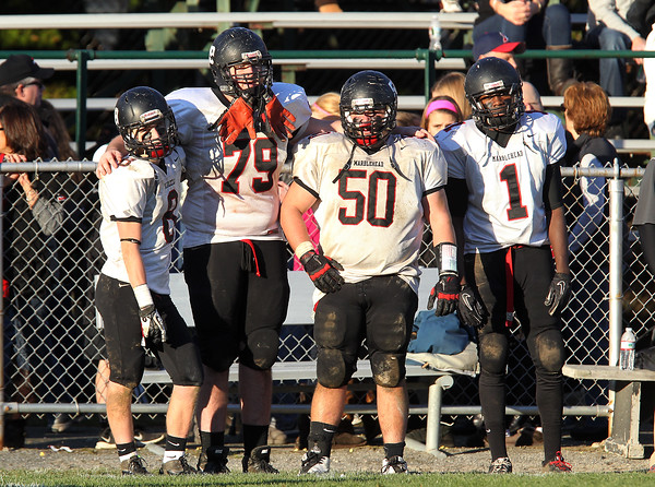 From left, Marblehead players Sam Stern, Derek Dumais, Kyle McCormack, and Romello Matthews, can only stand and watch as time expires in the NEC/CAL Tier 2 Championship game against Beverly on Saturday afternoon. The Magicians dropped to the Panthers 35-14 at Hurd Stadium.