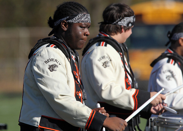 Beverly High School senior drummer Jose Sanchez plays the drums during the Beverly HS Band pregame show on Saturday afternoon. David Le/Staff Photo