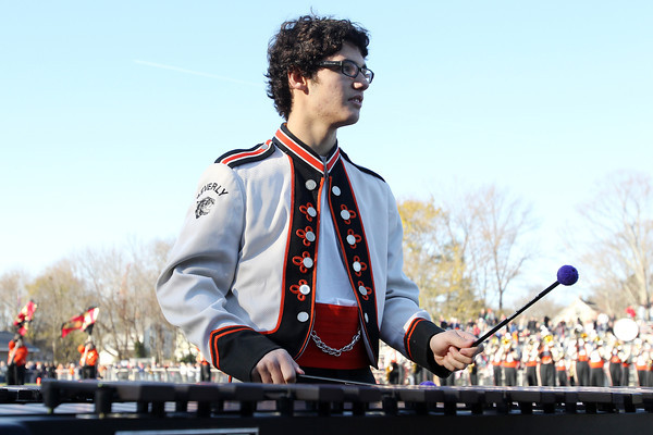 Beverly High School sophomore Ralph Ferrigno, plays the xylophone during the BHS Band's halftime show on Saturday afternoon. David Le/Staff Photo