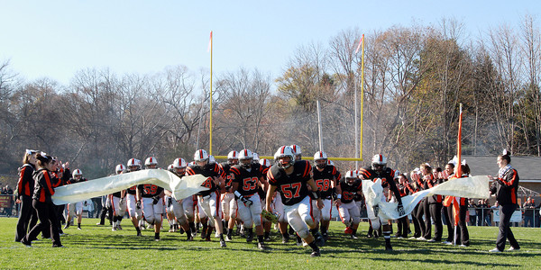 The Beverly High School Panthers rush onto the field to take on the Magicians on Saturday afternoon at Hurd Stadium. David Le/Staff Photo
