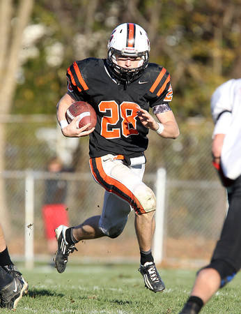 Beverly senior running back Kenny Pierce looks for running room against Marblehead on Saturday afternoon. David Le/Staff Photo