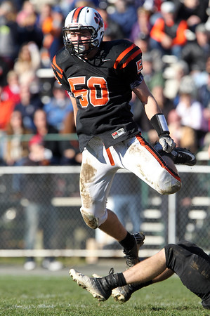 Beverly junior defensive end Zach Duguid leaps up in celebration after stopping Marblehead running back Brooks Tyrrell for a loss on Saturday afternoon. The Panthers defeated the Magicians 35-14 at Hurd Stadium to move to a perfect 10-0 and captured the NEC/CAL Tier 2 Championship in the process. David Le/Staff Photo