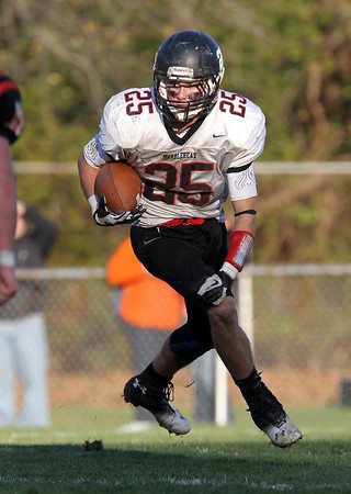 Marblehead senior running back Zac Cuzner looks for running room against Beverly on Saturday afternoon. David Le/Staff Photo
